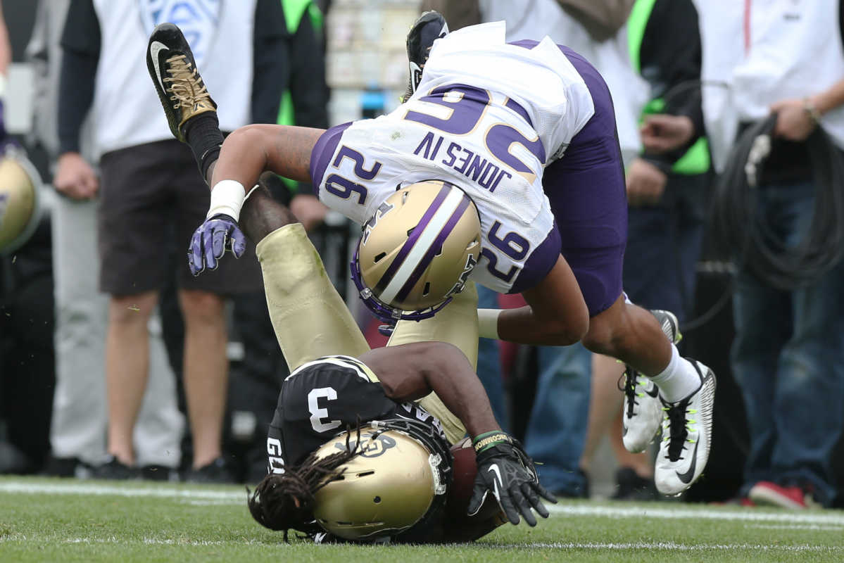 Washington defensive back Sidney Jones, top, tackles Colorado wide receiver D.D. Goodson after a reception in the first quarter of a game in Boulder, Colo., on Saturday, Nov. 1, 2014.