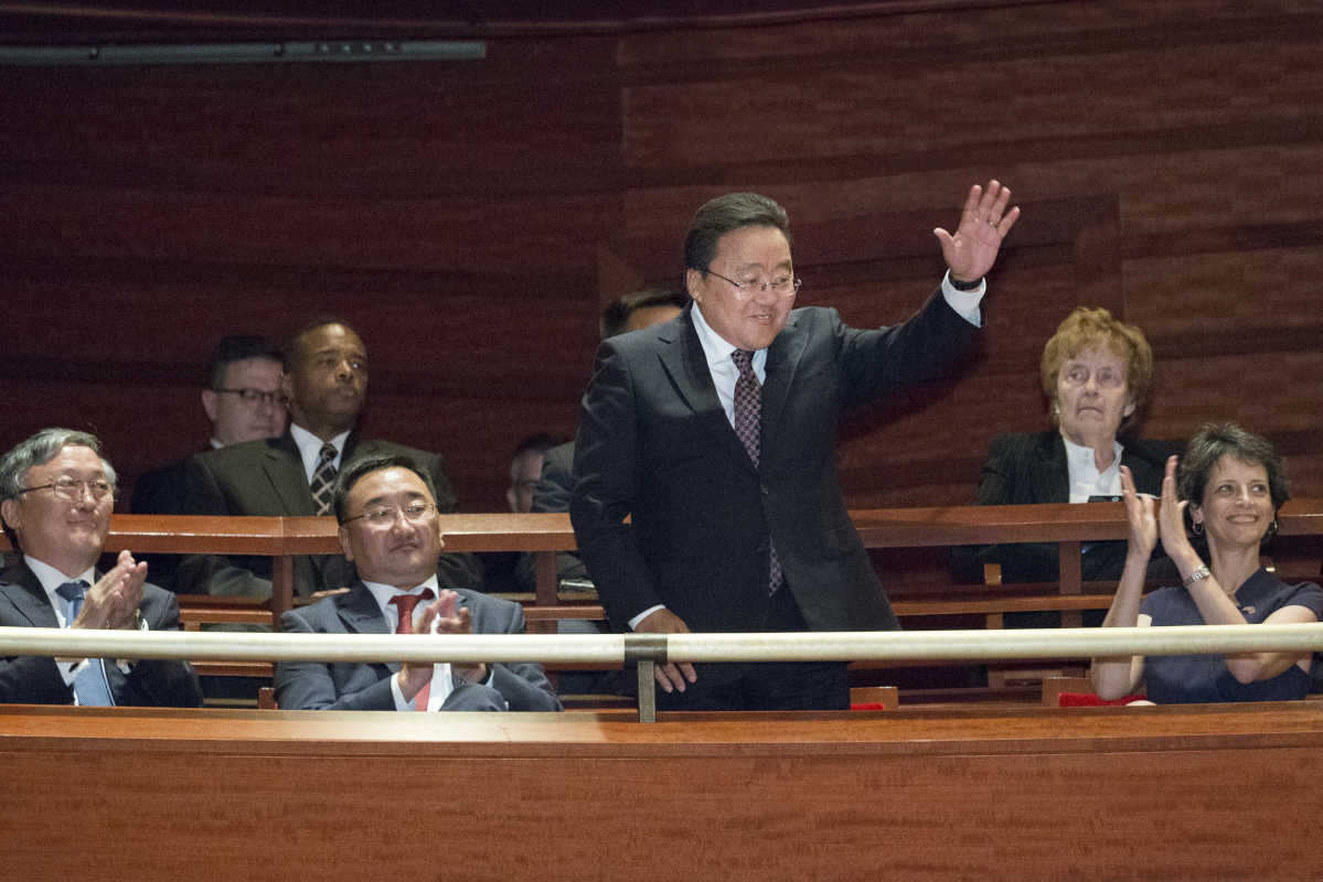 Mongolian President Tsakhiagiin Elbegdorj acknowledges the audience's applause after being introduced from stage at the start of the Philadelphia Orchestra's concert in Verizon Hall at the Kimmel Center, Friday, Sept. 23, 2016, in Philadelphia. President Elbegdorj is in Philadelphia at the invitation of Ms. Vulgamore and the Orchestra for a daylong visit. ( JESSICA GRIFFIN / Staff Photographer)