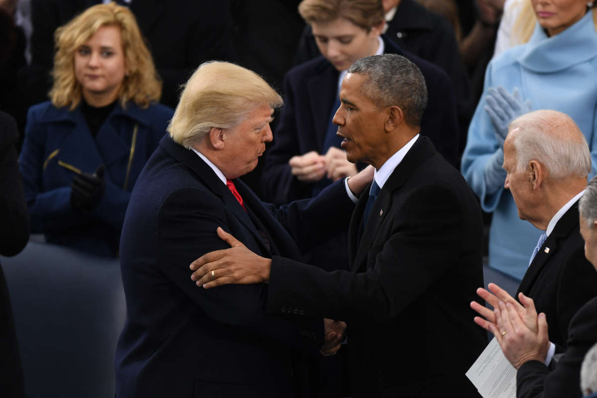 President Donald Trump shakes hands with former president Barack Obama at Trump's inauguration.