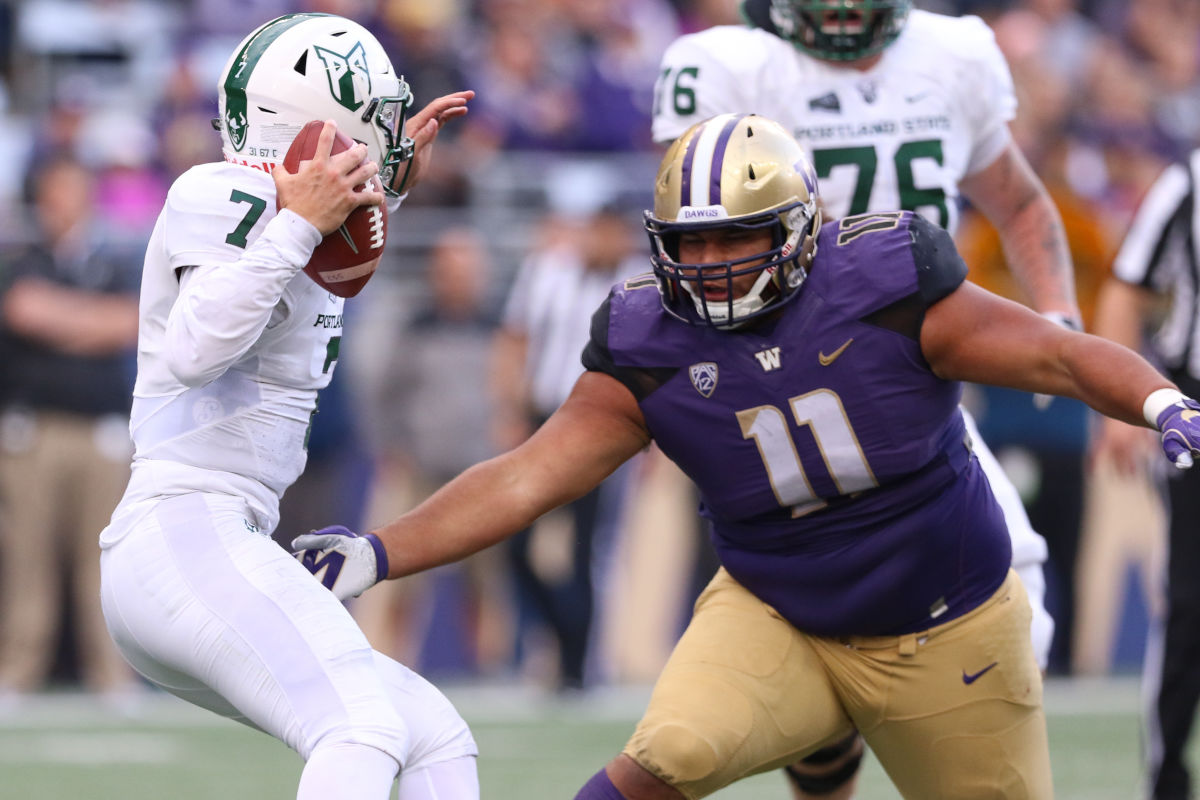 The Eagles drafted University of Washington defensive tackle Elijah Qualls (No. 11) in the sixth round of the 2017 NFL draft. In this photo, Qualls chases Portland State quarterback Alex Kuresa during a game on Sept. 17, 2016 at Husky Stadium in Seattle, Wash.