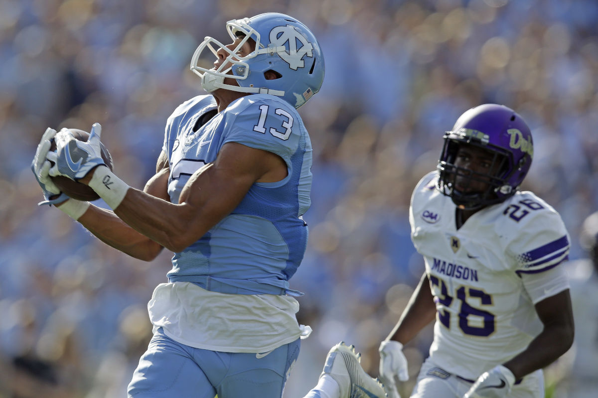 North Carolina´s Mack Hollins (13) catches a touchdown pass as James Madison´s Curtis Oliver chases in the first half of an NCAA college football game in Chapel Hill, N.C., Saturday, Sept. 17, 2016.