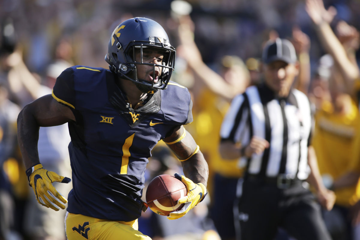 The Eagles drafted West Virginia wide receiver Shelton Gibson in the fifth round of the 2017 NFL draft. In this photo from  Sept. 10, 2016, Gibson (1) runs for a touchdown after a catch during the first half of a game against Youngstown State, in Morgantown, W.Va.