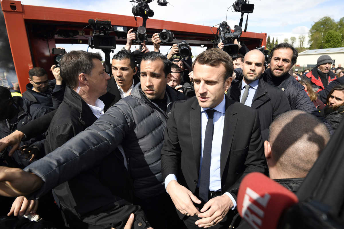 French centrist presidential election candidate Emmanuel Macron arrives outside the Whirlpool home appliance factory Wednesday in Amiens, northern France.
