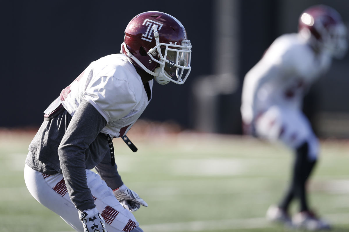 Cornerback Nate Hairston, left, waits for a play to start during Temple football practice on November 22, 2016.  Hairston was selected in the fifth round, 158th overall, by the Indianapolis Colts in the NFL Draft on Saturday, April 29, 2017.