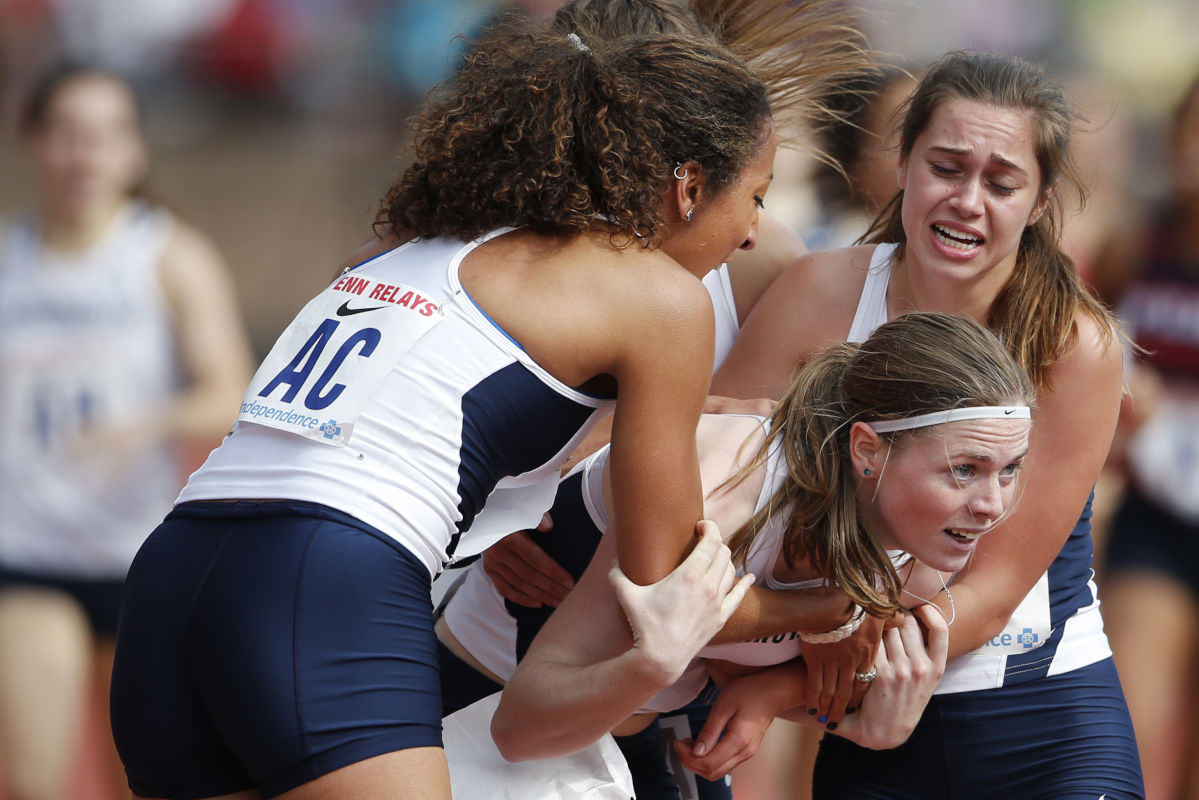 Anchor runner Siofra Cleirigh Buttner, center, of Villanova  is swarmed by teammates Angel Piccirillo, left, and Nicole Hutchinson, right,  after they won the College Women's 4x800m Championship of America on April 29, 2017 at Franklin Field.  It was their third victory in the relays.