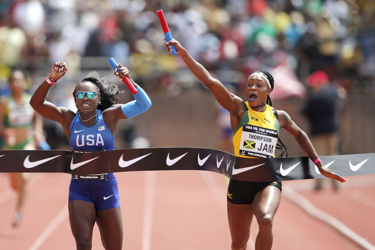 Elaine Thompson, left, of Jamaica edges out Morolake Akinosun, left, of the USA Red team in the USA vs. the World 4x100m race on April 29, 2017 at Franklin Field.  It was their third victory in the relays.