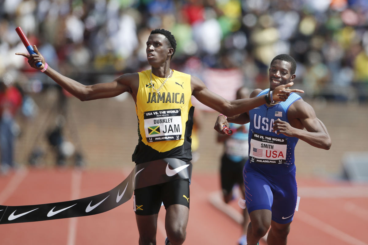 Fitzroy Dunkley, left, of Jamaica edges out Calvin Smith, right, of the USA Red team in the USA vs. the World Mens 4x400m race on April 29, 2017 at Franklin Field.