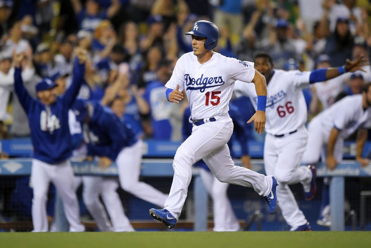 The Dodgers' Austin Barnes heads home with the winning run Saturday on a single by Adrian Gonzalez during the ninth inning against the Phillies,  The Phils lost, 6-5.  (AP Photo/Mark J. Terrill)