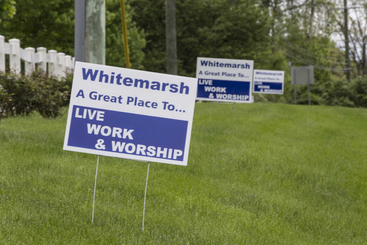 "Several blue and white signs that say  Whitemarsh  ""A Great Place to Live Work and Worship"" on  Joshua Road in Whitemarsh, PA.  The lone Republican supervisor in Whitemarsh wants to change the township's slogan to include the word ""worship."""