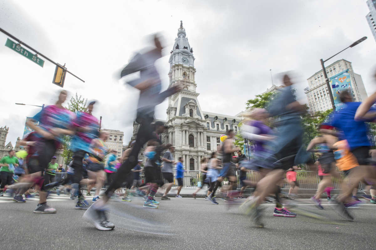 Some of the 40,000 runners in the 2017 Broad Street Run pass City Hall on their way to the finish in South Philadelphia.