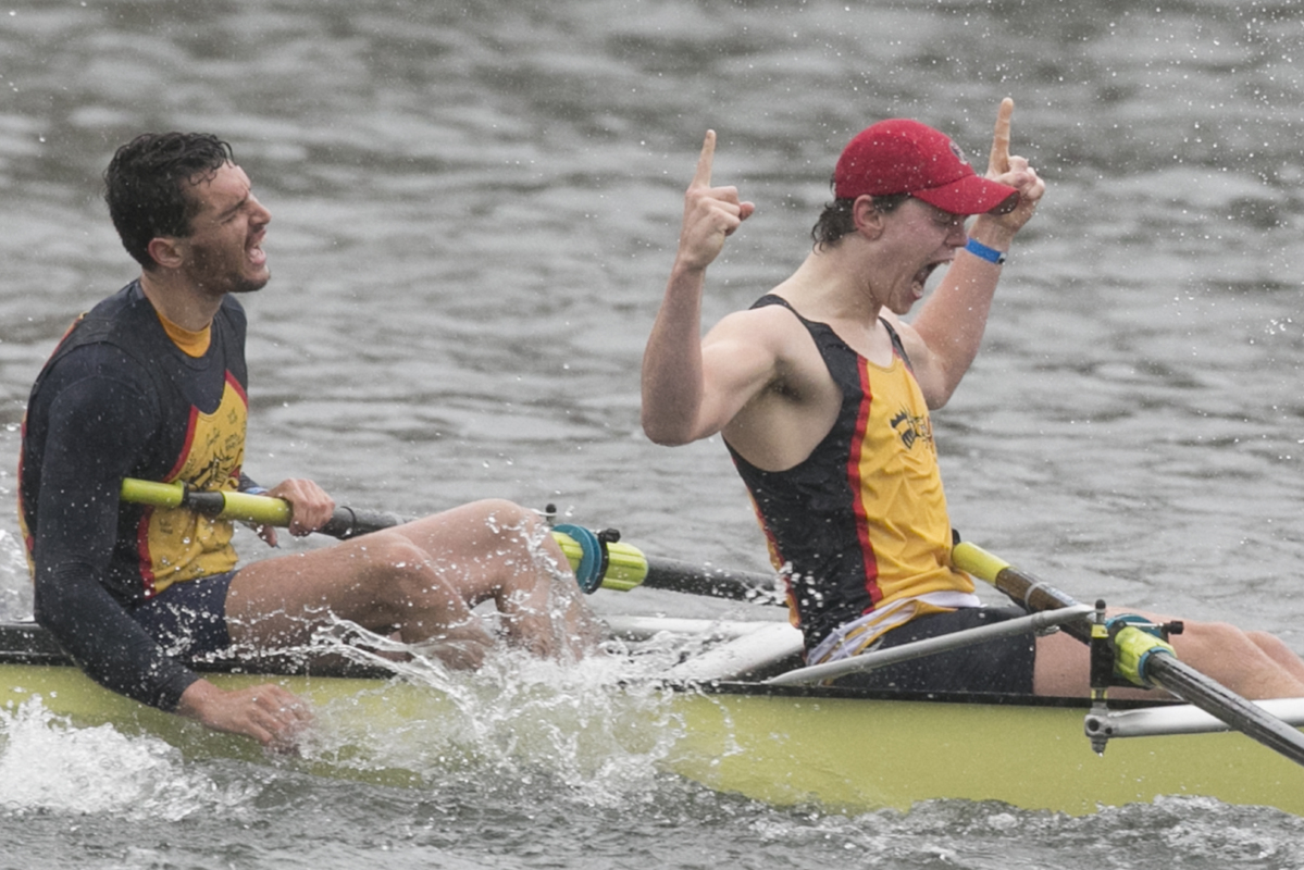 Drexel University rowers Ivo Krakic (left) and  Justin Best, members of the mens varsity eight, celebrate after winning Saturday morning.