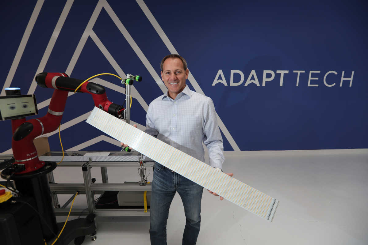 Joe Wolf holds a board of small LEDS at Adapt Technologies in West Conshohocken, the Philadelphia area&acute;s first maker of energy-efficient LED lighting.<br />