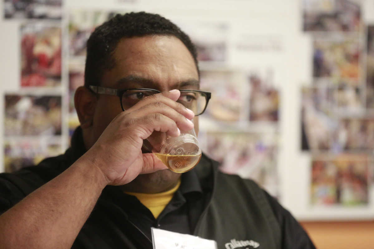 Wardell Massey, a judge, tastes a beer at The Inquirer´s eighth annual Brewvitational at Reading Terminal Market .
