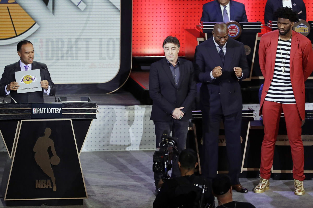 The Los Angeles Lakers´ card is shown during the 2017 NBA draft lottery, signifying the Lakers will pick second in the June draft. Joel Embiid (red coat, far right) represented the Philadelphia 76ers. To Embiid´s right are Lakers president of basketball operations Magic Johnson and Boston Celtics co-owner Wyc Grousbeck.