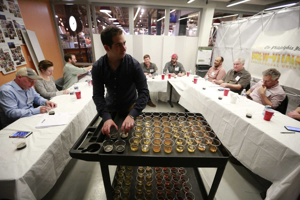 Judges consider an array of beers at the eighth Brewvitational at Reading Terminal Market.