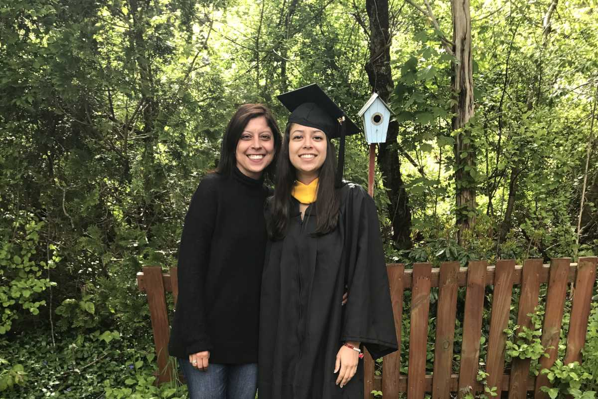Columnist Helen Ubinas poses with her niece after her graduation from Sacred Heart University.