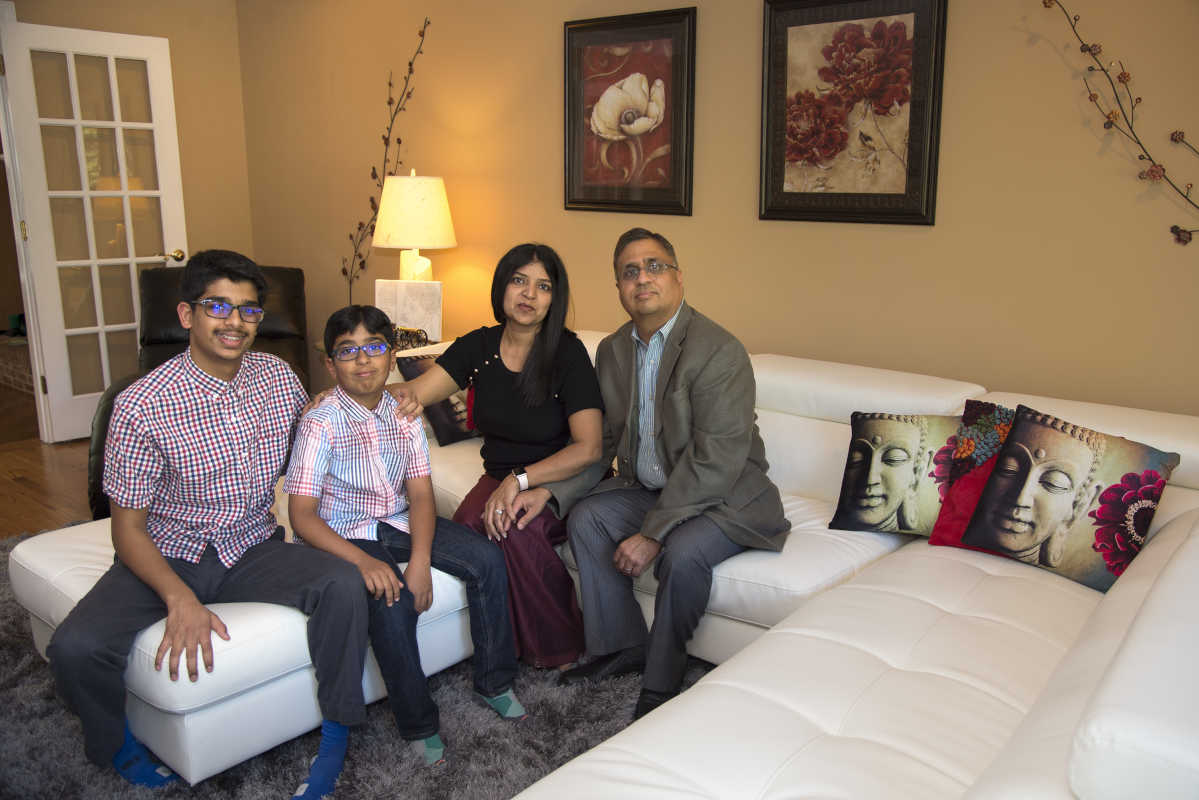 Dell Joshi (right) and Sudha Joshi pose with their children Viraj (left), 14, and Varoon, 9, in living room of their Chadds Ford home May 17, 2017. Unionville-Chadds Ford public schools voted to make the Hindu autumn festival of Diwali an official school holiday – the first district in Pennsylvania to officially mark the day. TOM GRALISH / Staff Photographer