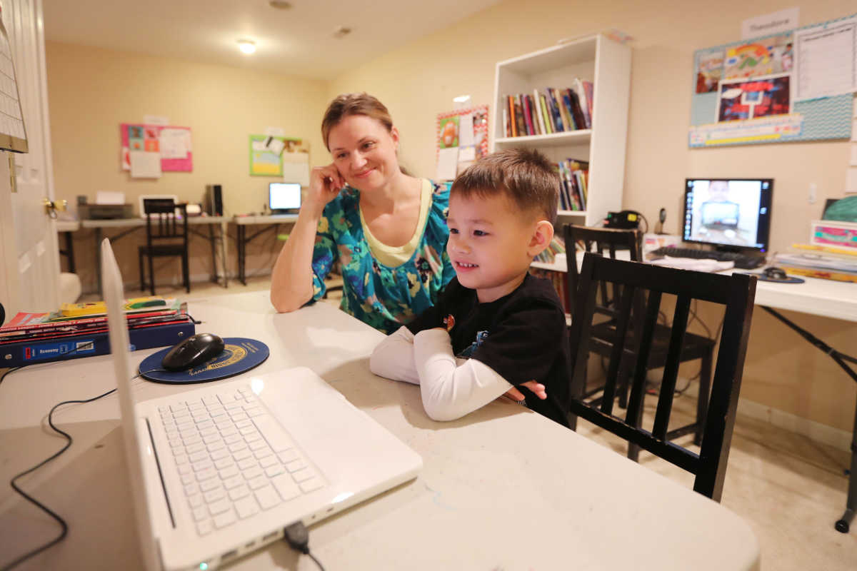 Tim, 4, and his mother Rebecca Pollock talk with speech therapist Elizabeth Willis of the Chester County Intermediate Unit via laptop at their Coatesville home.