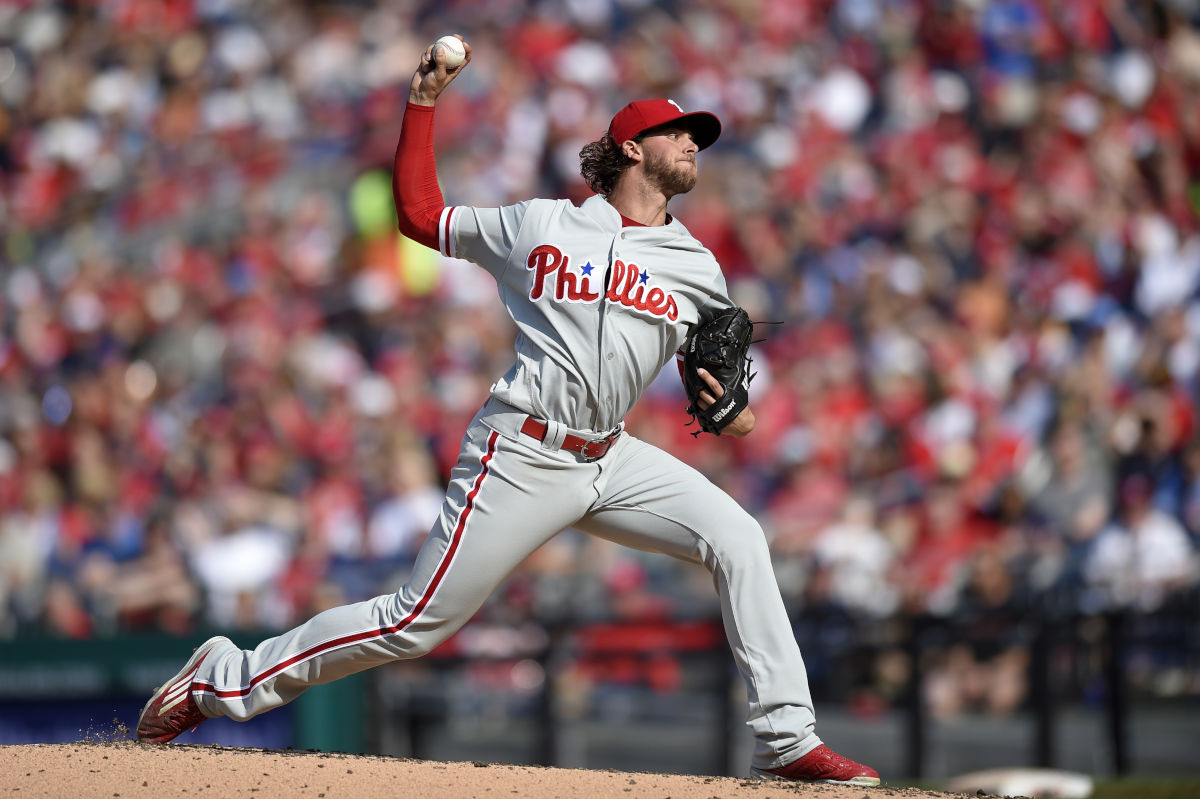Phillies starting pitcher Aaron Nola delivers a pitch during the second inning of a baseball game against the Washington Nationals, Friday, April 14, 2017, in Washington.