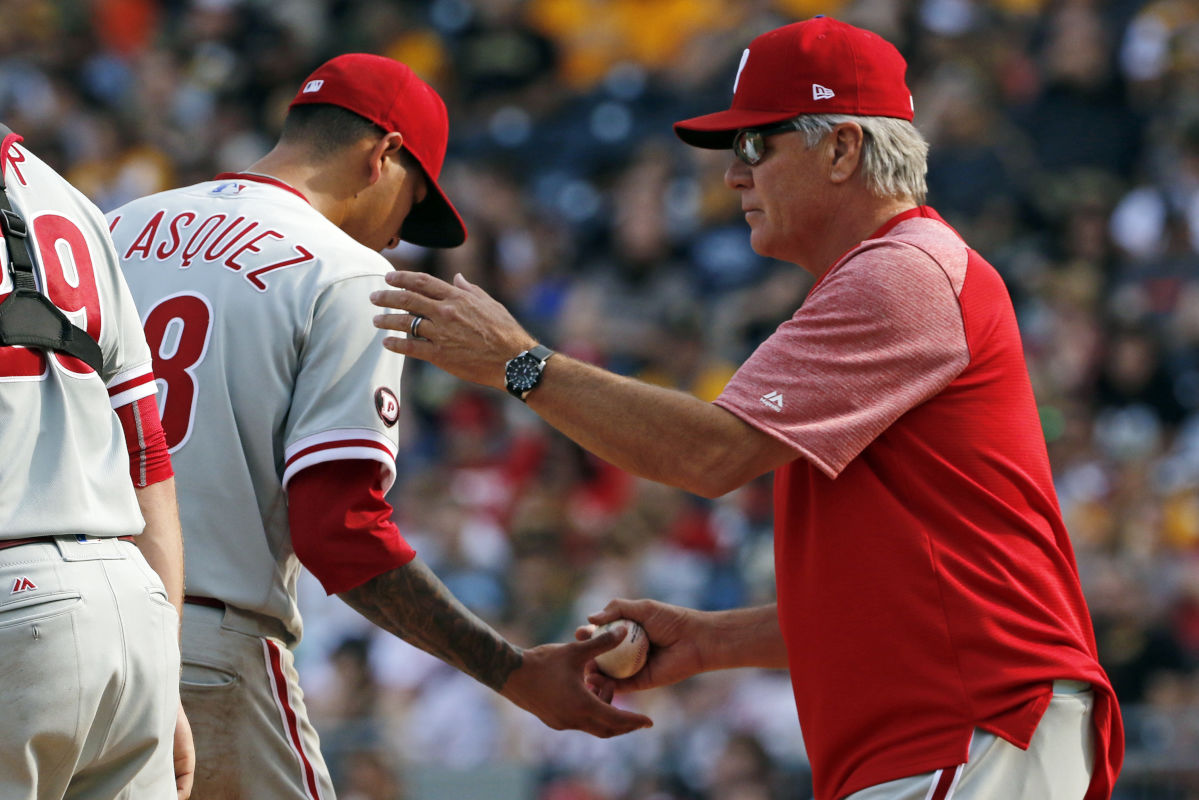 Phillies manager Pete Mackanin, right, takes the ball from starting pitcher Vince Velasquez in the sixth inning of a baseball game against the Pirates in Pittsburgh, Saturday, May 20, 2017.