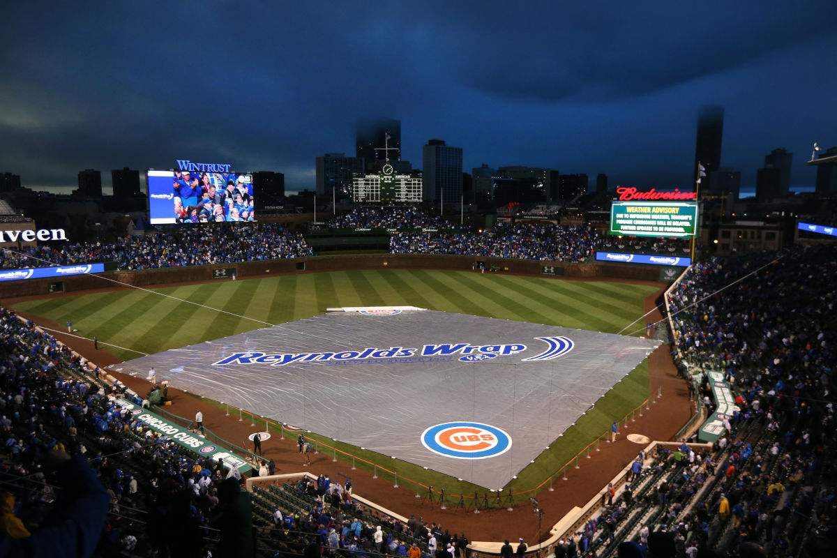 A tarp covers the field during a rain delay before the game between the Chicago Cubs and the Los Angeles Dodgers on Monday, April 10, 2017 at Wrigley Field in Chicago, Ill.