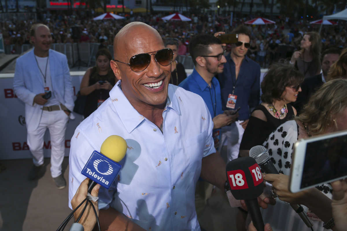 "Dwayne ""The Rock"" Johnson talks to the press during the ""Baywatch"" movie world premiere's beach party and red carpet event on Saturday, May 13, 2017 in Miami Beach, Fla. (Matias J. Ocner/Miami Herald/TNS)"