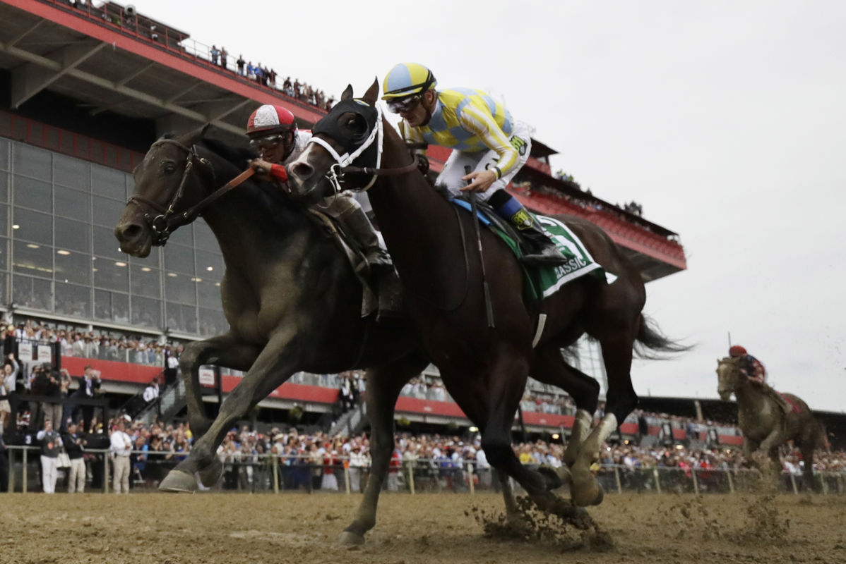 Cloud Computing (left) edges Classic Empire to win Preakness Stakes on Saturday.<br />