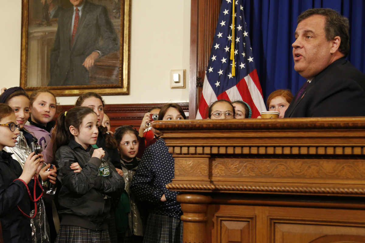 School children from Lakewood, N.J. watch as New Jersey Governor Chris Christie speaks at a news conference in his offices in Trenton, N.J., Monday, May 22, 2017. Christie is touting the state's 4.1 percent unemployment rate as he urged voters in this year's race for governor not to vote for candidates who will reverse his policies. (AP Photo/Seth Wenig)