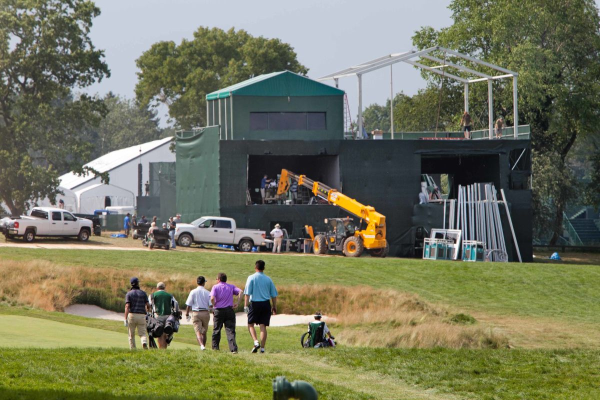 Golfers on the 14th hole with media tower in background being dismantled as Merion Golf Club begins the tear-down from the U.S. Open, Ardmore, June 17, 2013.