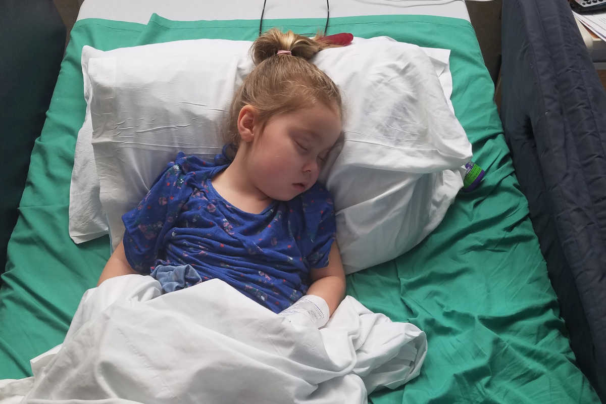 Emma Farrington, 5, sleeps at CHOP, after yet another seizure caused by Rett Syndrome.