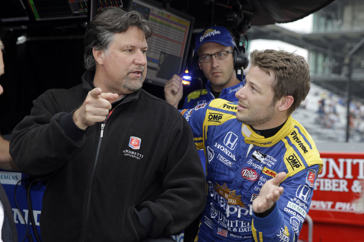Marco Andretti (right) talks with car owner and father Michael Andretti during a practice session for the Indianapolis 500 auto race at Indianapolis Motor Speedway in Indianapolis, Friday, May 20, 2016.