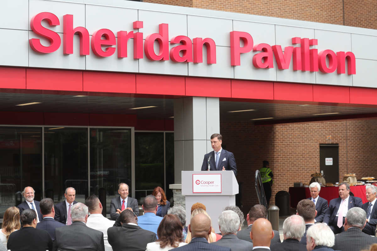 Mark Sheridan, son of the late John and Joyce Sheridan, speaks at the ceremony in which Cooper University Health System formally renamed 3 Cooper Plaza after the couple on Wednesday.