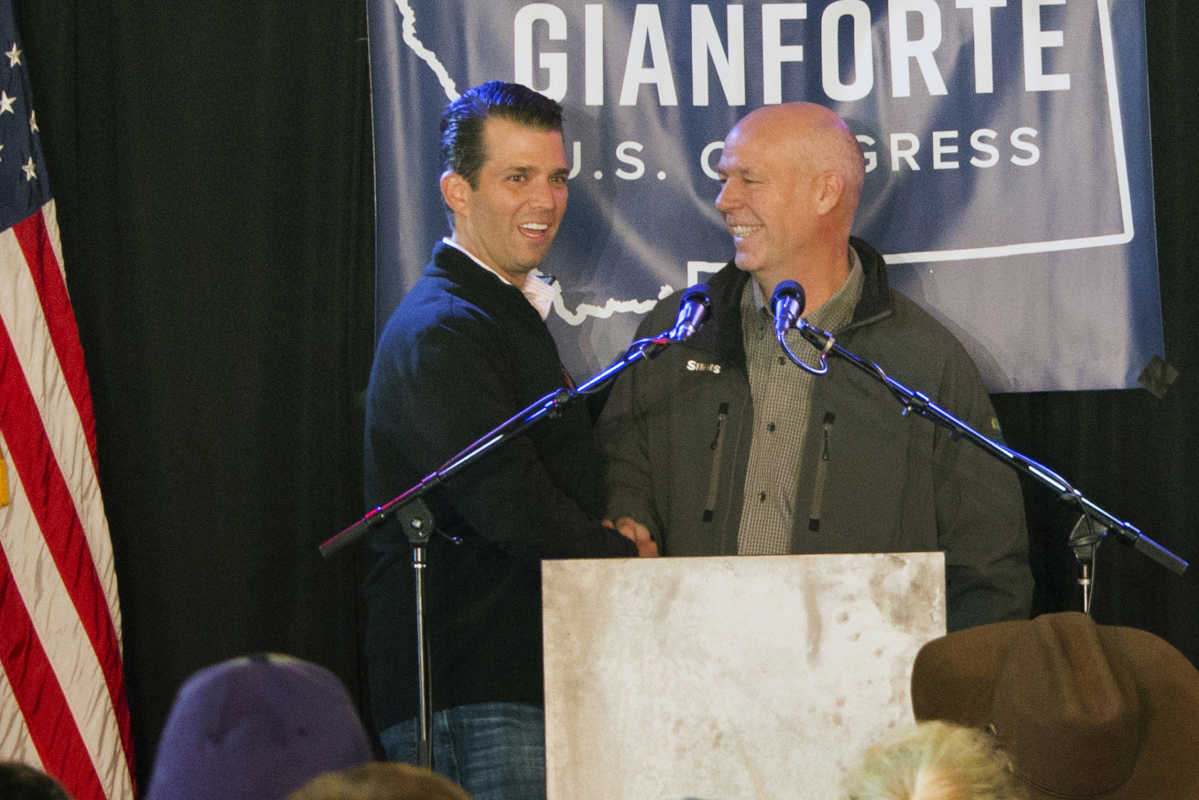 Republican Greg Gianforte, right, welcomes Donald Trump Jr., the president's son, onto the stage at a rally in East Helena, Montana, on May 11.