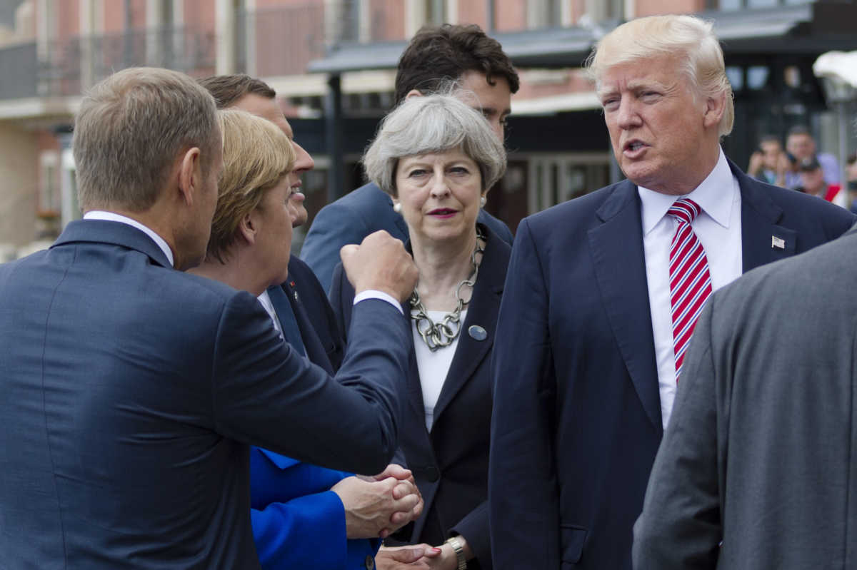 From left, President of the European Council Donald Tusk gesticulates as he talks with German Chancellor Angela Merkel, French President Emmanuel Macron (partially hidden), British Prime Minister Theresa May, and U.S. President Donald Trump prior to the start of the leaders of the G7 countries summit in Taormina, Italy, on Friday.
