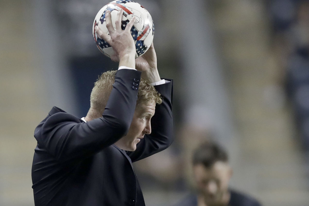 Union Head Coach Jim Curtin holds the soccer ball against the Houston Dynamo on Wednesday, May 17, 2017.  YONG KIM / Staff Photographer