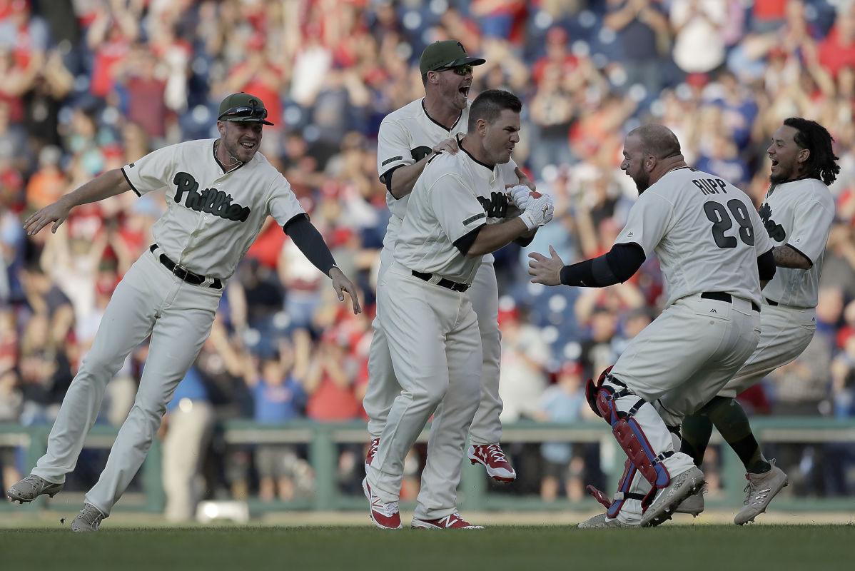 The Phillies´ Tommy Joseph celebrates his game winning ninth-inning hit with his teammates against the Cincinnati Reds on Saturday, May 27, 2017 in Philadelphia.