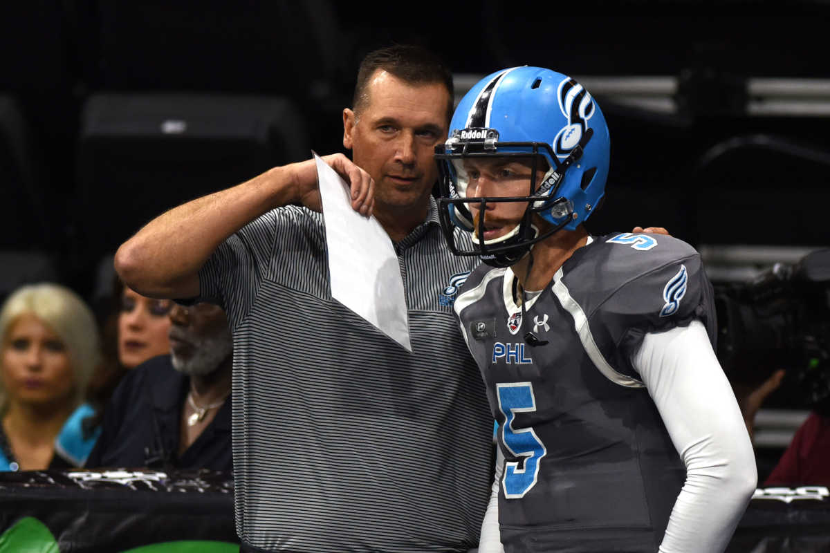 Soul Coach Clint Dolezel, left, confers with quarterback Dan Raudabaugh, right, during the first quarter aginst Tampa Bay Storm in the Round One Arena Football playoff game Sunday Aug. 7, 2016 in Allentown, Pa. Raudabaugh threw for 148 yards and five touchdowns in Saturday´s 48-47 win over Washington.