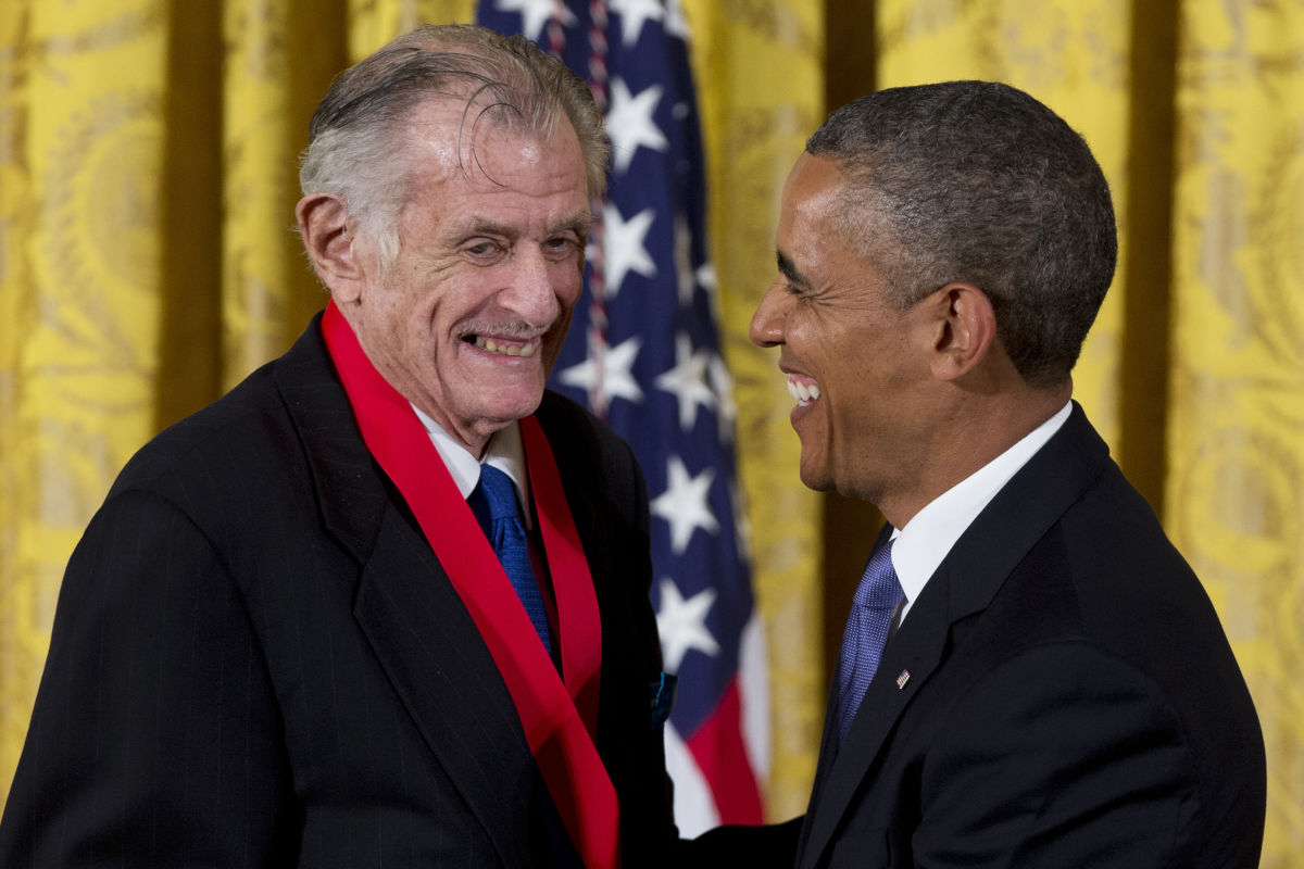 President Barack Obama laughs with Frank Deford as he awards him the 2012 National Humanities Medal for transforming how we think about sports, during a ceremony in the East Room of White House, Wednesday, July 10, 2013, in Washington.