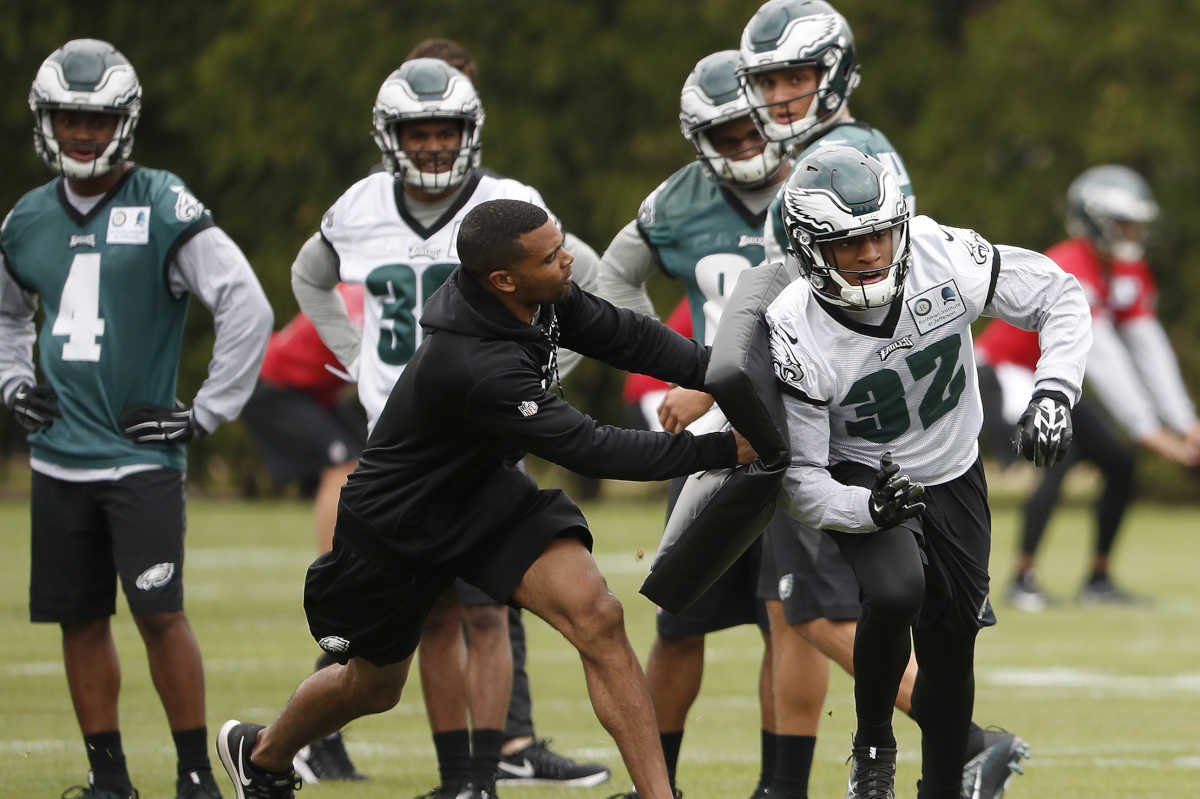 Eagles' Rasul Douglas (right) bounces off a block during a drill at Eagles rookie camp at the NovaCare Complex.