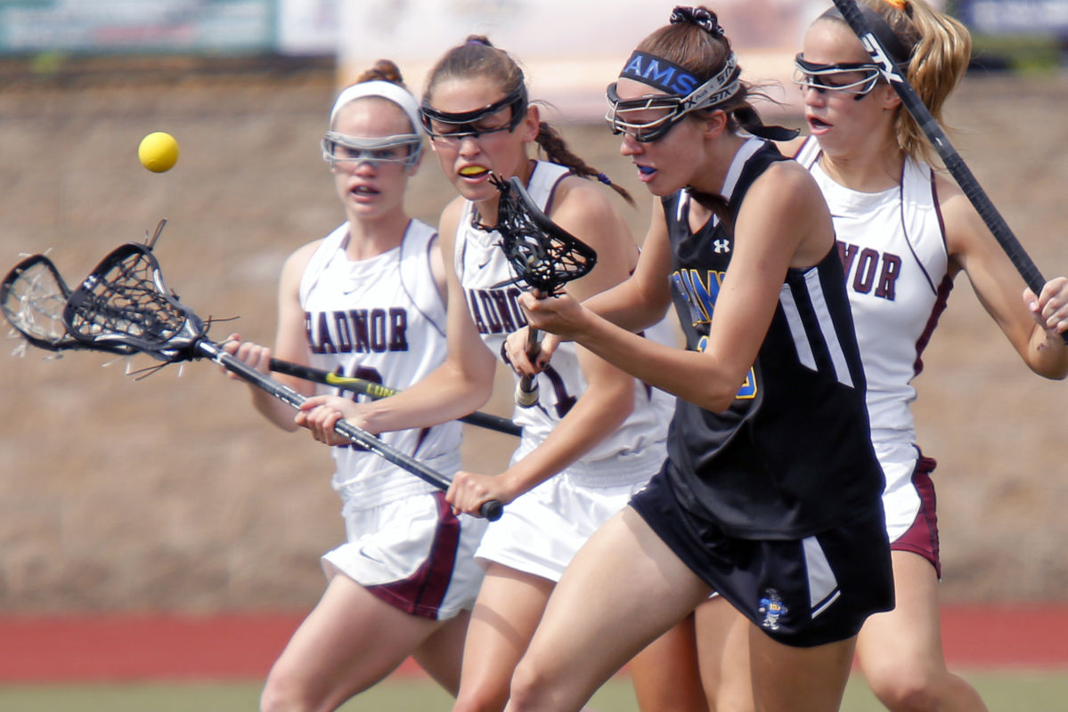 Radnor teammates (from left) Hope Smith, Nicole Massimino and Julianne Puckette eye a loose ball with Kennard Dale's Kayli Ashenfelter during the first half of the PIAA Class 2A girls' lacrosse state final Saturday, June 10, 2017 at West Chester East. Radnor went on to win the championship, 20-8. LOU RABITO / Staff