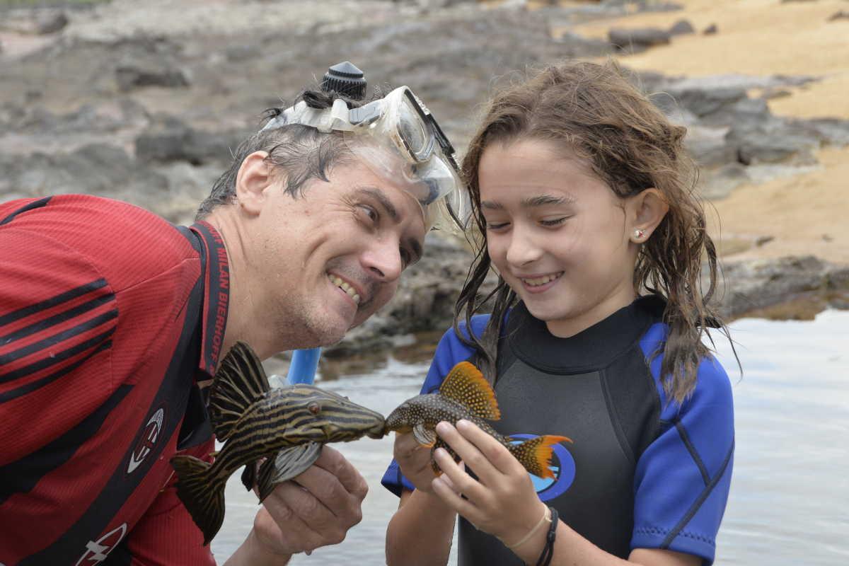 "Mark (left) holding ""Panaque armbrusteri,"" Sofia  (right) holding ""Scobinancistrus pariolispos,"" both popular species of plecos in the aquarium hobby."