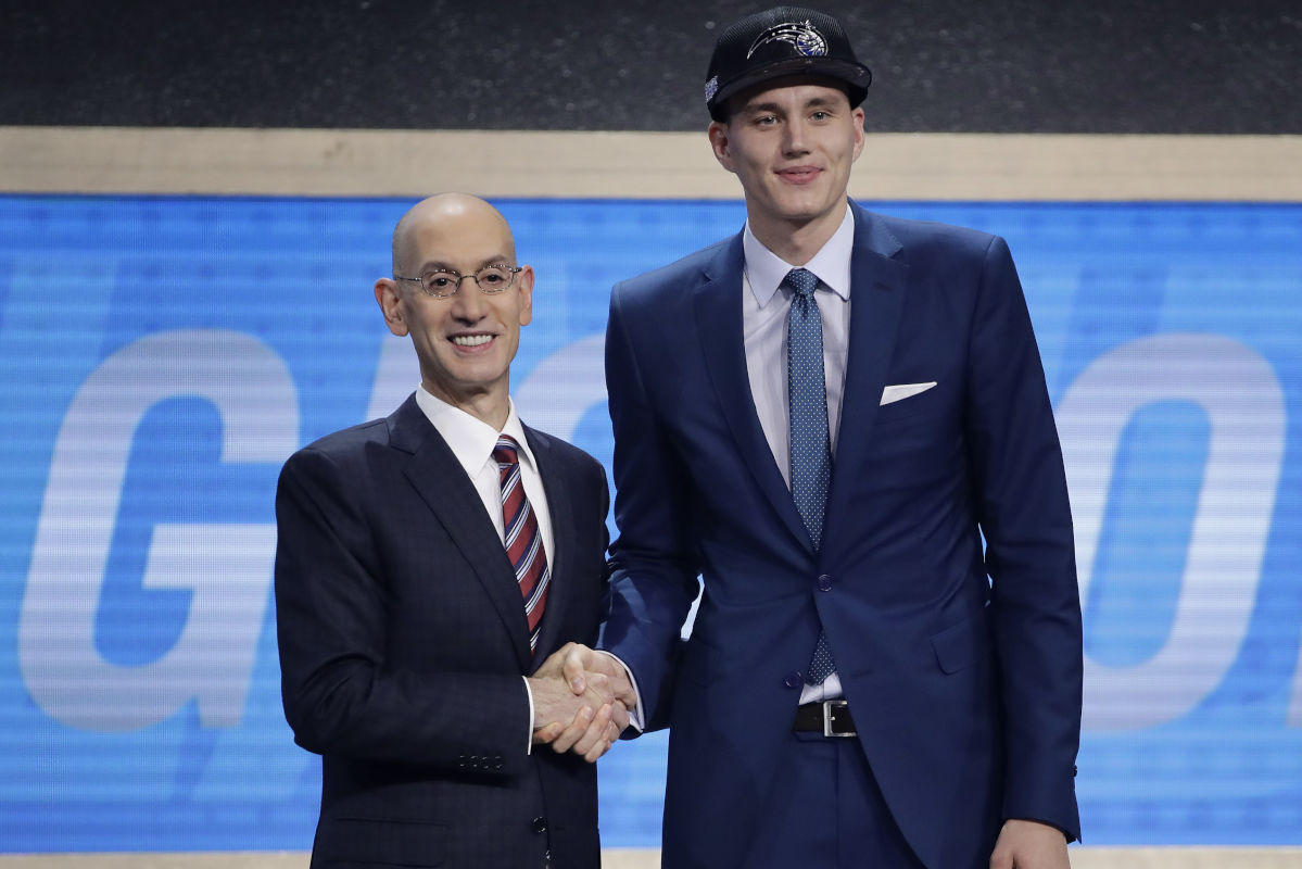 Anzejs Pasecniks (right) poses with NBA Commissioner Adam Silver after being selected by the Orlando Magic - on the Philadelphia 76ers' behalf - as the 25th pick in the 2017 draft.