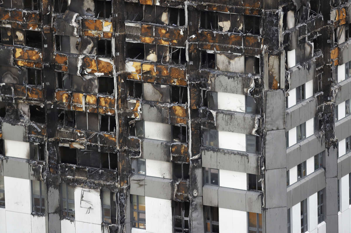 The bottom part of the burnt Grenfell Tower in London. The massive fire raced through the 24-story high-rise apartment building in west London early on June 14.