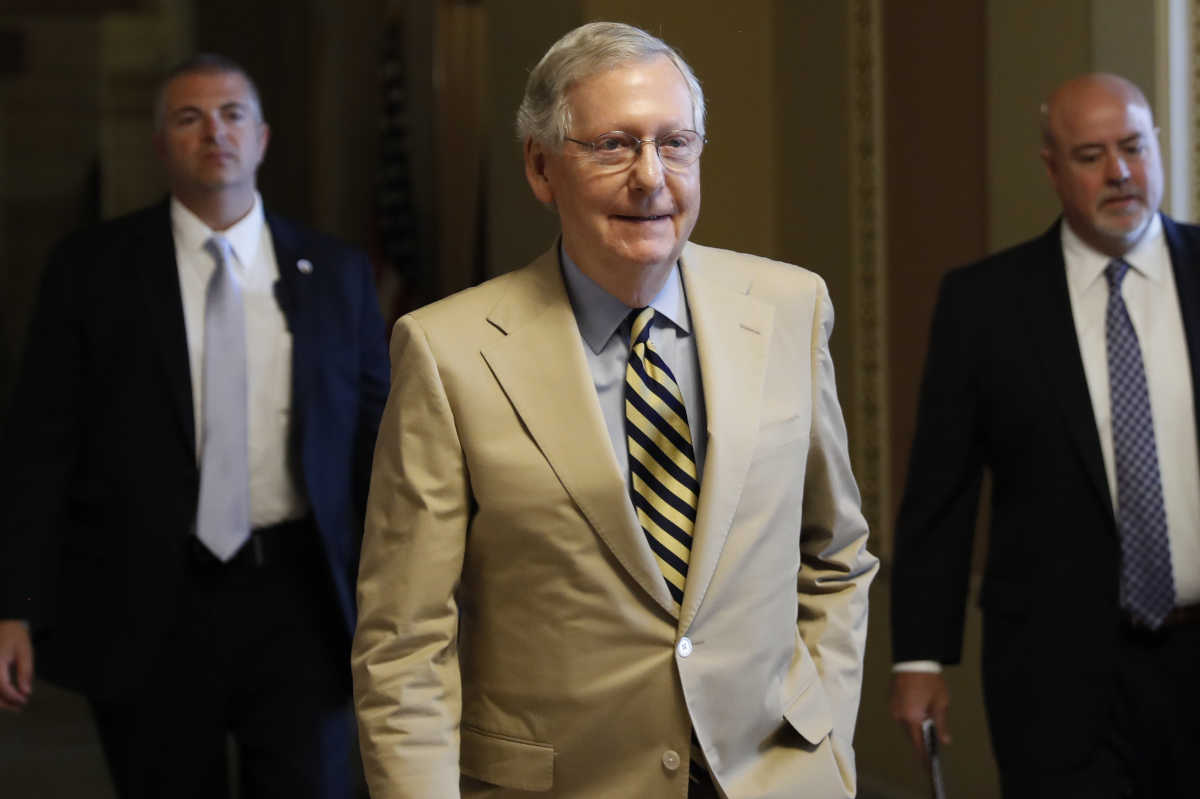 "Senate Majority Leader Mitch McConnell of Ky. walks from his office on Capitol Hill in Washington, Monday, June 26, 2017. Senate Republicans unveil a revised health care bill in hopes of securing support from wavering GOP lawmakers, including one who calls the drive to whip his party's bill through the Senate this week ""a little offensive."""