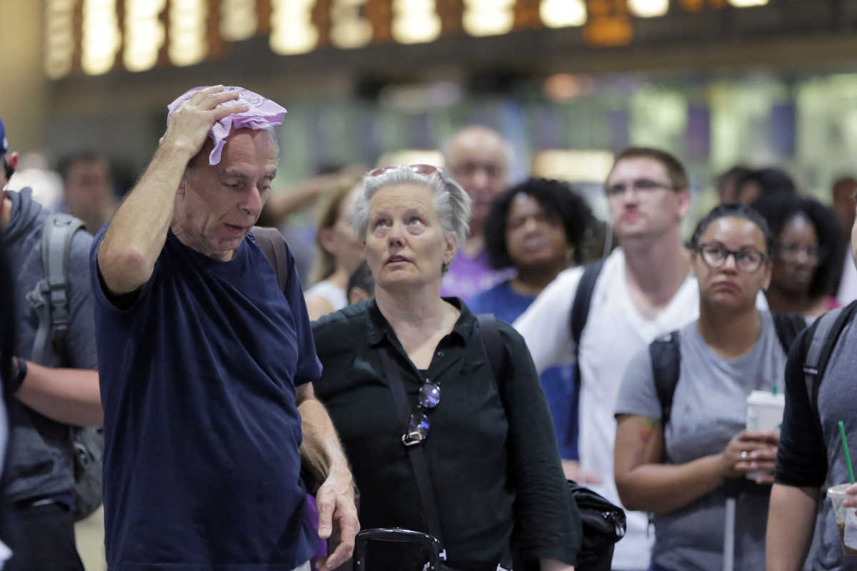 Long Island Rail Road passengers wait for their trains in New York's Penn Station, Tuesday, July 18, 2017. Track repairs and corresponding schedule cutbacks for commuters began last week. Amtrak is replacing aging signals and several thousand feet of track over a two-month period following two derailments and other problems.