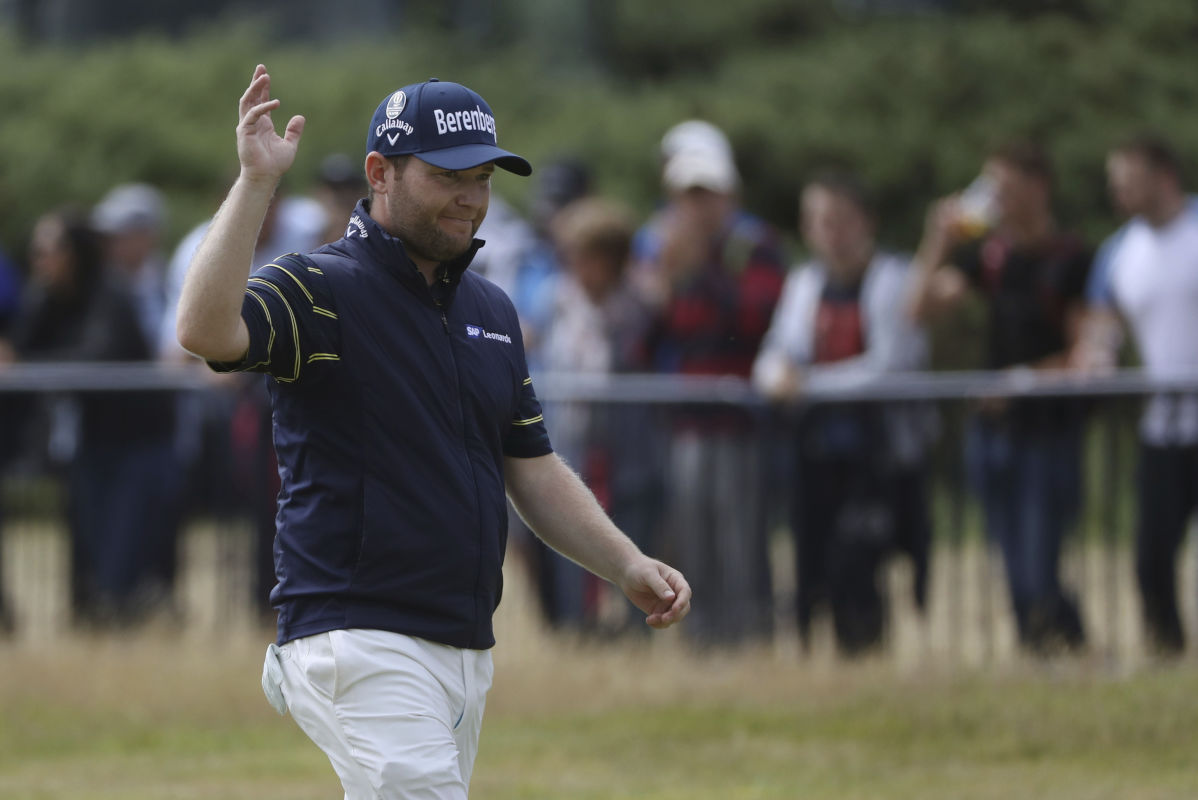 South Africa's Branden Grace waves as he makes his way along the 18th fairway during the third round of the British Open Golf Championship, at Royal Birkdale, Southport, England, Saturday July 22, 2017.