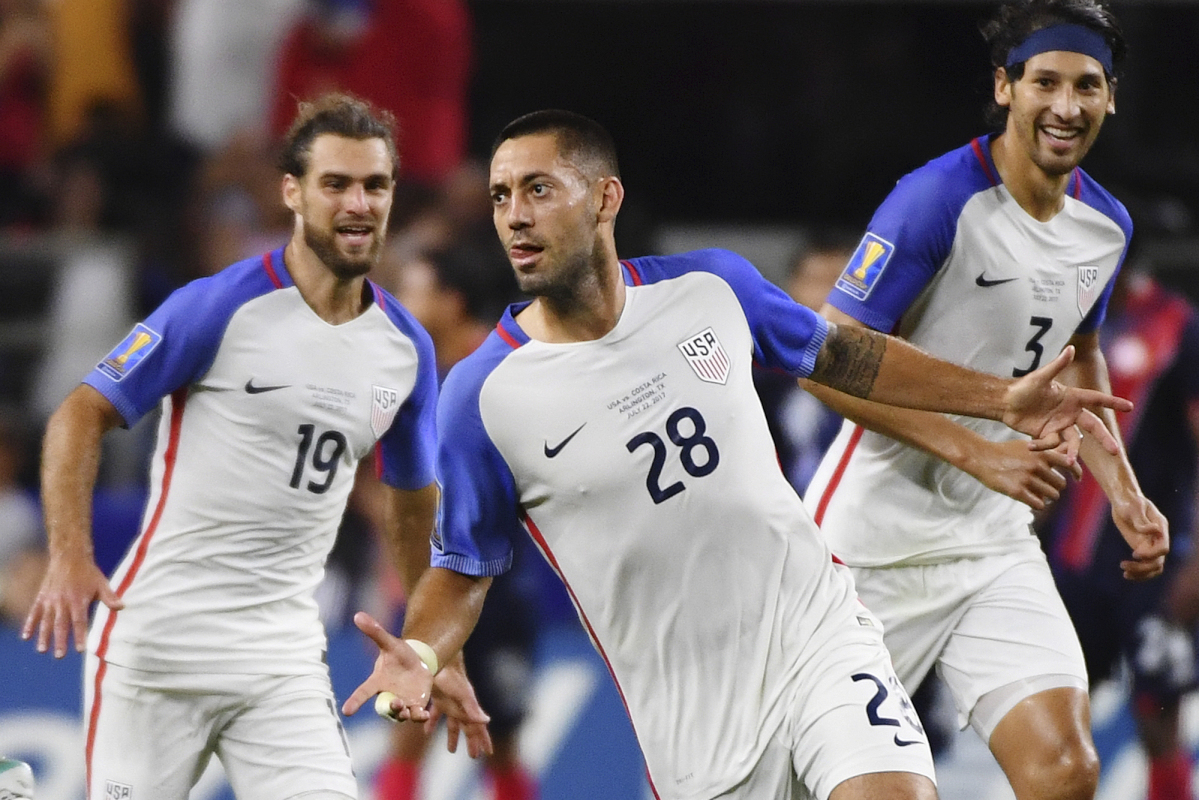 United States' Clint Dempsey (28) celebrates with teammates Graham Zusi, left, and Omar Gonzalez, right, after scoring a goal during a CONCACAF Gold Cup semifinal soccer match against Costa Rica in Arlington, Texas, Saturday, July 22, 2017.