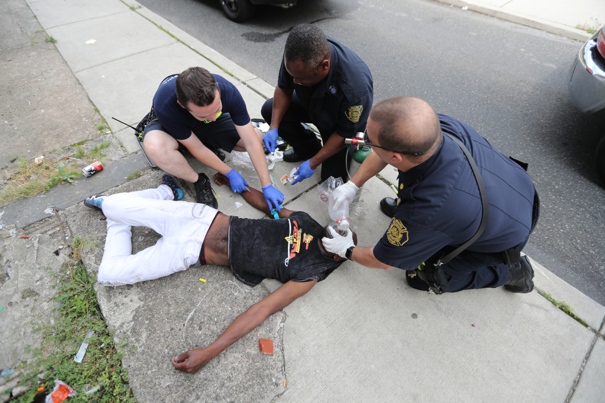 An unidentified man suspected of overdosing is administered narcan by Philadelphia Fire personnel on Witte Street in Kensington in June of 2017.