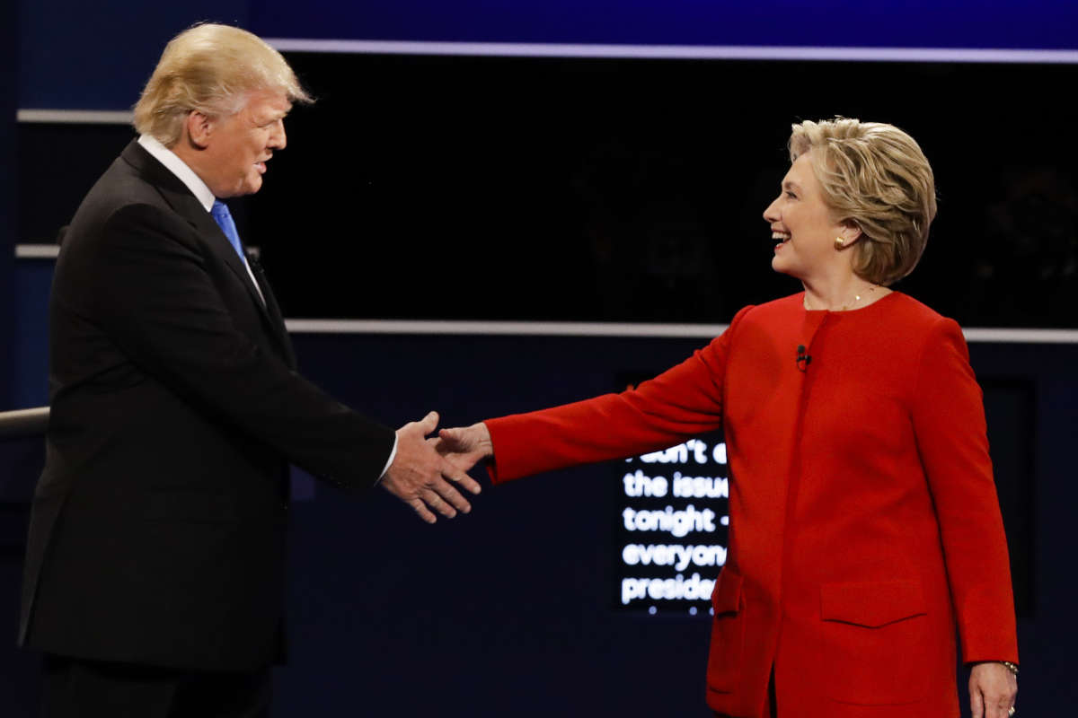Donald Trump and Hillary Clinton shake hands during a presidential debate at Hofstra University in Hempstead, N.Y.. last year.