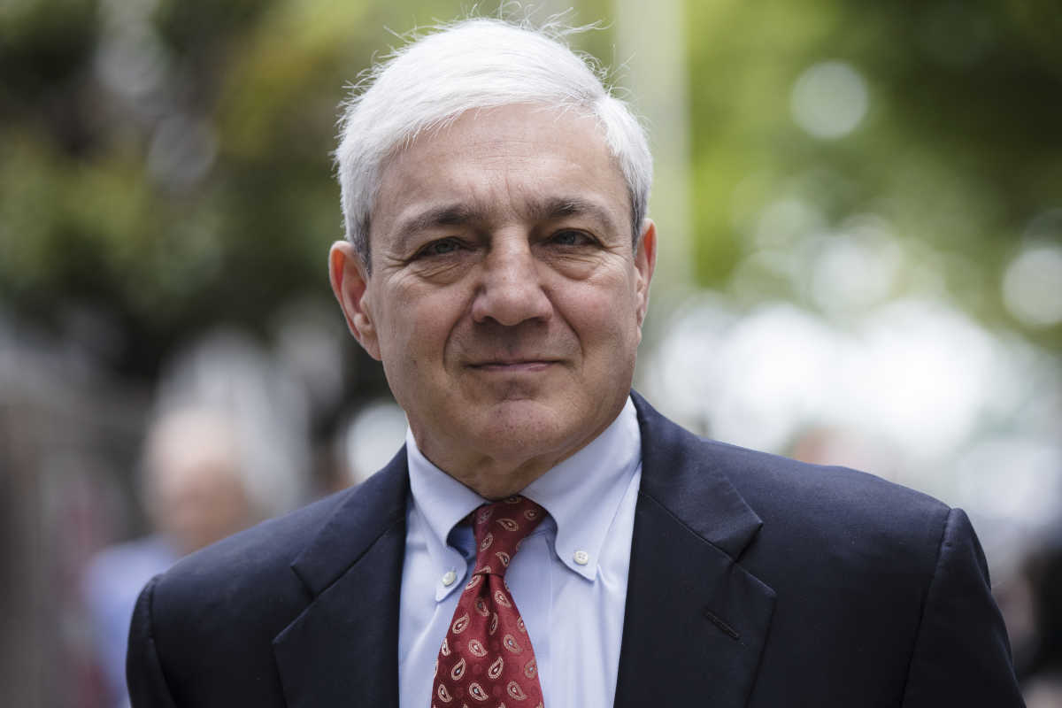 Former Penn State President Graham Spanier said a report by Louis Freeh harmed his reputation and income.